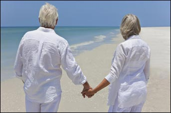 Couple holding hands on a beach